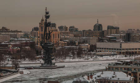 A picture of the Monument to Peter I and the surrounding frozen river.
