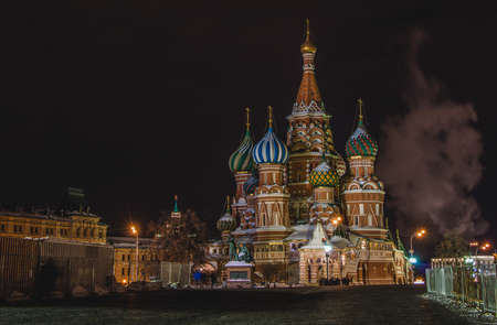 A picture of Saint Basils Cathedral at night.