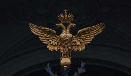 A picture of a golden eagle with two heads towering the central gates of the Hermitage.