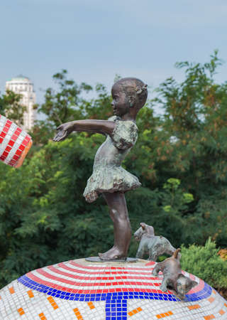 A picture of a sculpture featuring a little girl in the Peizazhna Alley (Kiev). Stock Photo