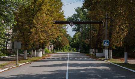 A picture of a Chernobyl street surrounded by trees with different folliage color. Stock Photo