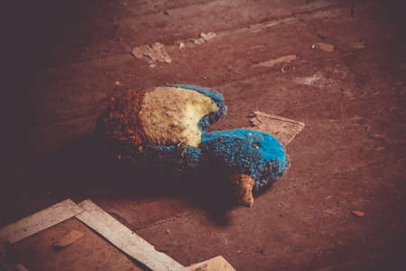 A picture of an abandoned stuffed animal inside a kindergarten.
