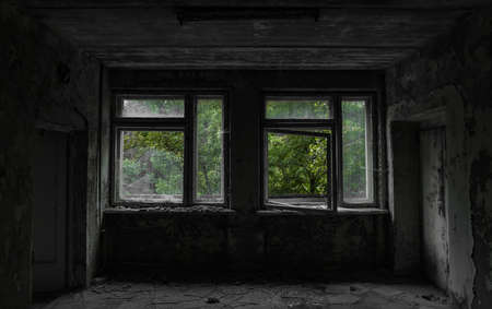 A picture of the hospital of Pripyat against the lush vegetation outside.