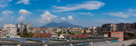 A picture of Mount Vesuvius as seen by a building in the center of Naples.