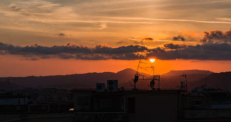 A picture of urban rooftops at sunset (Naples).
