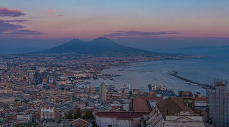 A picture of Naples featuring Mount Vesuvius in the distance, at sunset. Editorial