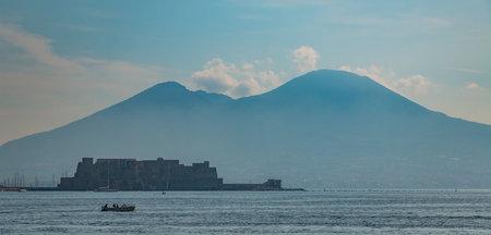 A picture of Castel dellOvo shadowed by Mount Vesuvius. Editorial