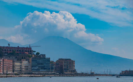 A picture of some buildings in the San Ferdinando district with Mount Vesuvius in the back (Naples).