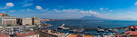 A panorama of Naples featuring the port area and Mount Vesuvius. Editorial