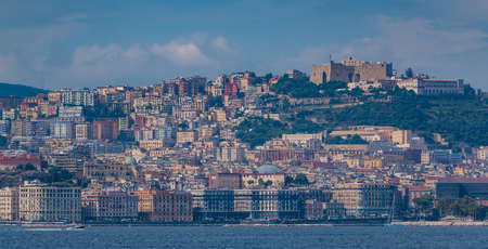A picture of Naples promenade and Castel SantElmo taken from a ferry.