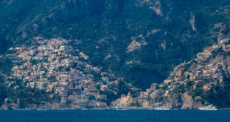A picture of the small town of Positano, in the Amalfi Coast, taken from across the shore.