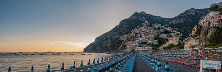 A panorama picture of Positano, at sunset, taken from the beach.