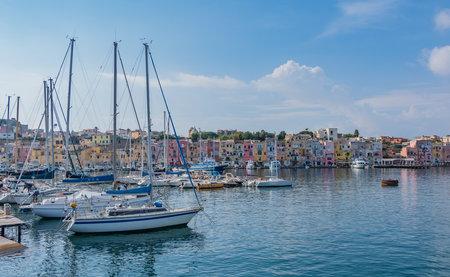 A picture of the Marina di Procida actual marina, promenade and colorful buildings. Editorial