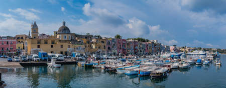 A panorama of the Marina di Procida actual marina, promenade and colorful buildings. Editorial