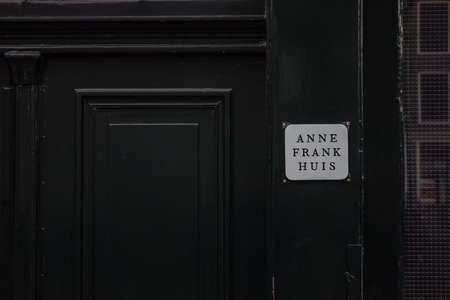 A picture of the small sign marking the entrance of the Anne Frank House, in Amsterdam.
