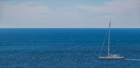 A picture of a sailing boat on the shore of Dubrovnik (Croatia).