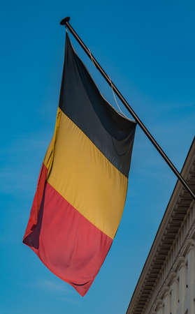 A picture of the Belgian flag on the facade of a building in the Place des Martyrs (Brussels).