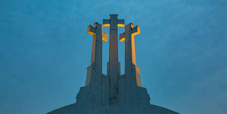 A picture of the Three Crosses monument, at sunset, in Vilnius.