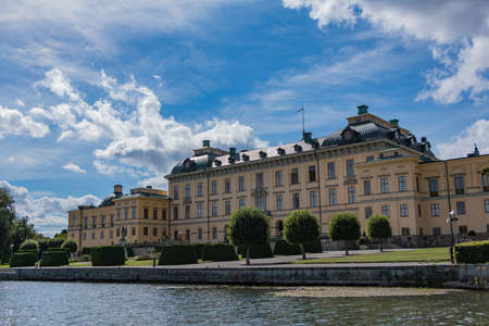 A picture of Drottningholm Palaces facade that faces the water. Editorial
