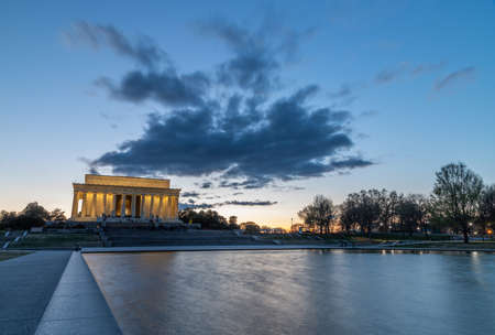 A picture of the Lincoln Memorial and the Reflecting Pool at sunset.