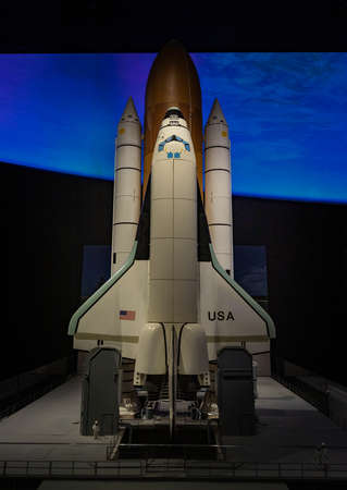 A picture of a space shuttle inside the Smithsonian National Air and Space Museum.
