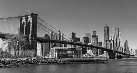 A black and white picture of Lower Manhattan and the Brooklyn Bridge.