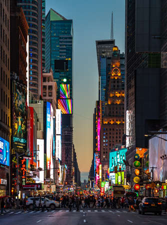 A picture of a steeet of New York at sunset, near Times Square.