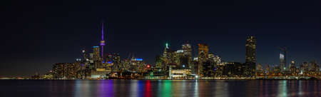 A panorama picture of Toronto at night.