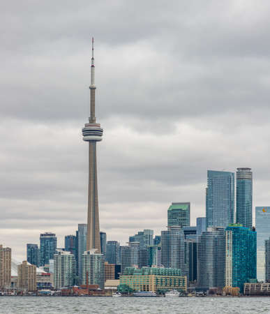 A picture of the CN Tower and nearby buildings taken from the islands across.