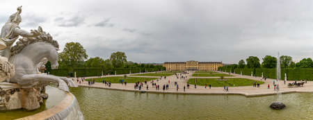 A panorama picture of Schönbrunn featuring the main palace and its gardens. Editorial