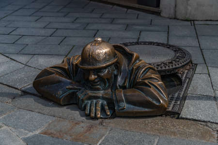 A picture of the famous statue of ÄŒumil, Man at Work (Bratislava).