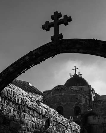 A black and white picture of one of the checkpoints of the Via Dolorosa next to the Church of the Holy Sepulchre (Jerusalem).