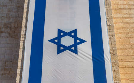 A picture of a large Israelian flag on display at the Safra Square.