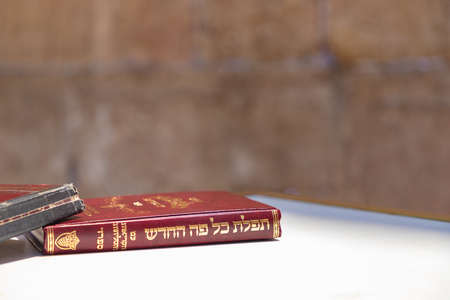 A picture of Hebrew Bibles on display next to the Wailing Wall.