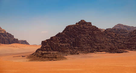 A picture of Wadi Rum's landscape with two camps visible. Stock Photo