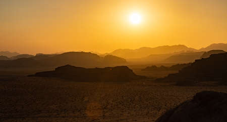 A picture of Wadi Rum's landscape at sunset.