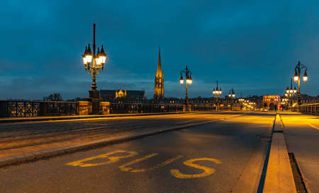 A picture of the Pont de Charles and the Basilica of St. Michael at night.