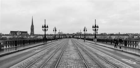 A black and white picture of the Pont de Pierre.