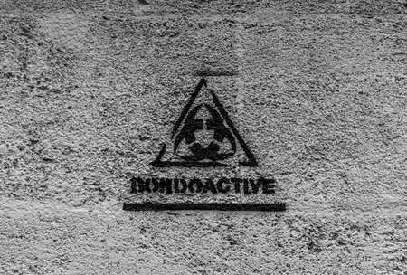 A black and white picture of a Bordeaux logo painted on a wall. Reklamní fotografie