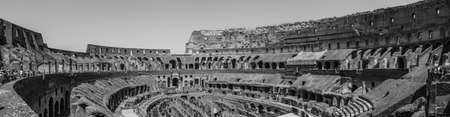 A black and white picture of the inside of the Colosseum, in Rome.