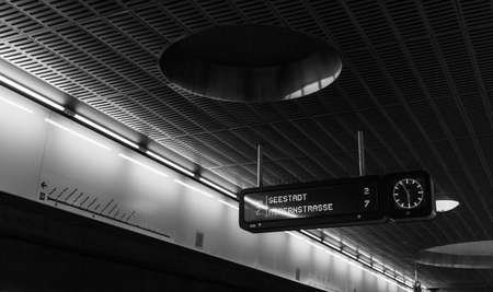 A black and white picture of the platform of the subway station Messe-Prater (Vienna).