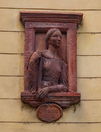 A picture of the statue of Julija Primic on display on a building's facade where she used to live.