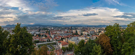 A panorama picture of the north side of Ljubljana at sunset.