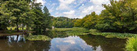 A panorama picture of a pond in Tivoli Park.
