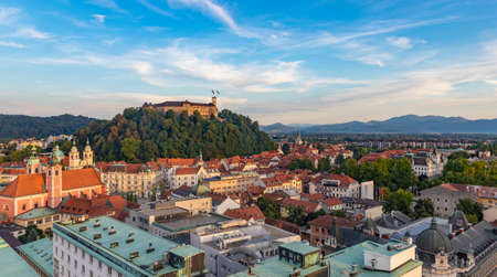 A picture of Ljubljana overlooked by the Ljubljana Castle at sunset.