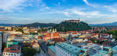 A panorama picture of Ljubljana overlooked by the Ljubljana Castle at sunset.