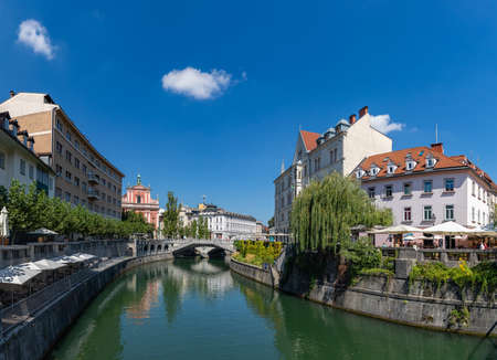A panorama picture of Ljubljana and the margins of the Ljubljanica river, centered on Prešeren Square and the Triple Bridge.