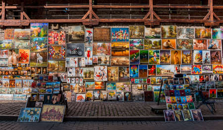 A picture of paintings on sale on Pijarska Street (Kraków).