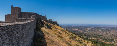 A panorama picture of the Marvão Castle overlooking the landscape.