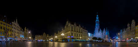 A panorama picture of the Market Square of Wroclaw taken at night.